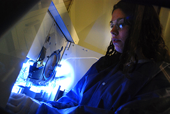 Victoria Czabafy '15 does forensic DNA analysis.
