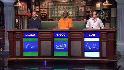 Seth Golberg, right, plays Sports Jeopardy! against two other contestants.
