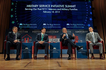 Former U.S. President George W. Bush, second from right, attended the national summit of 450 leaders.