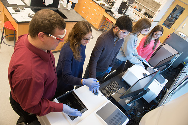 Chemistry faculty and staff, including lab supervisor Gary Bonomo, far left, agree the new equipment fosters a more research-intensive environment.