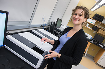 Chemistry professor Tara Kahan with one of the department's new spectrometers.