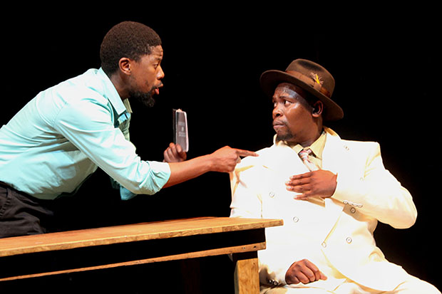 "Atandwa Kani and Mncedisi Shabangu in the Syracuse Stage production of Sizwe Banzi is Dead"" (Photograph by Ruphin Coudyzer)"