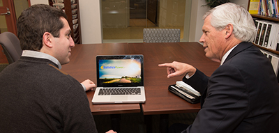 Terry Brown, executive director of the Falcone Center for Entrepreneurship, works with James Shomar, '13 MSE, '12, CEO of Solstice Power, a company he started in the Couri Hatchery.