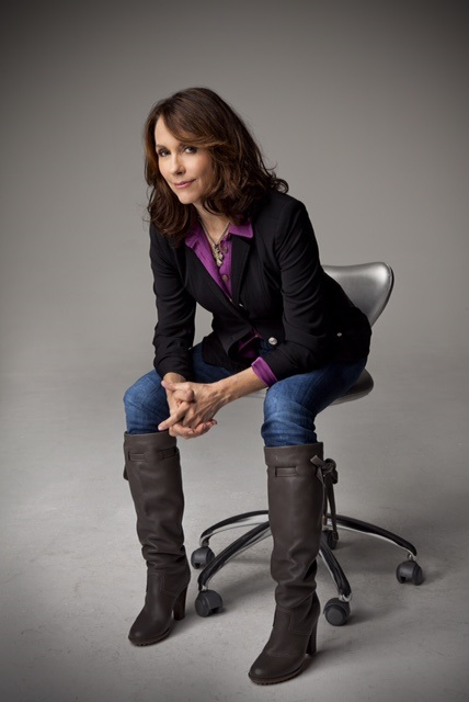 Mary Karr sitting on a chair