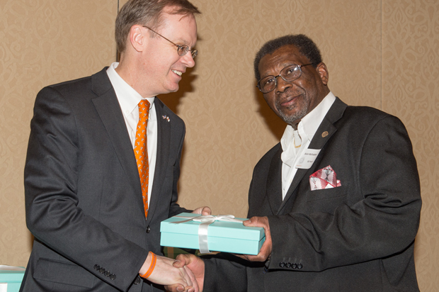 Chancellor Kent Syverud, left, congratulates Alvin McFadden on 50 years of service to Syracuse University.