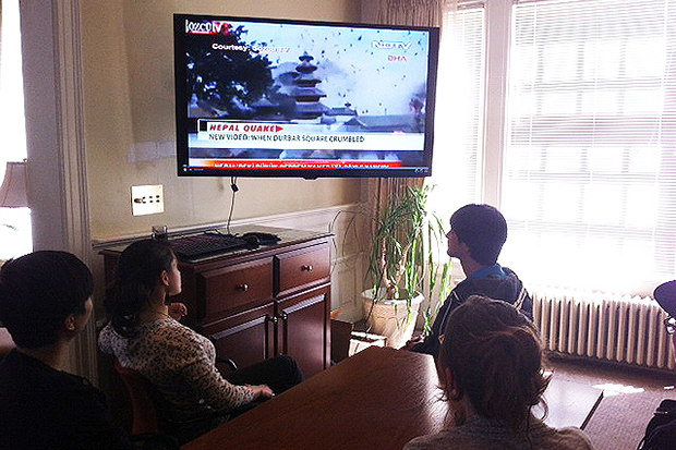 International students at the Slutzker Center follow CNN coverage of the earthquake in Nepal.