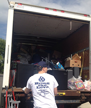 A volunteer helps out with pickups for Ten Tons of Love.