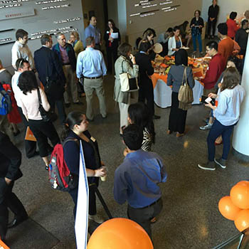 Attendees at the Cuse Conference mingle during a break.