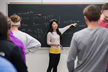 A graduate assistant teaches a class.
