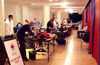 Students take part in Red Cross blood drive as part of this year's Blood Battle against Boston College.