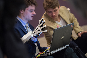 Contact, a student venture that employs the use of a robotic glove to interact with and manipulate computer programs, displays their prototype at the 2015 RvD IDEA Emerging Talk event.