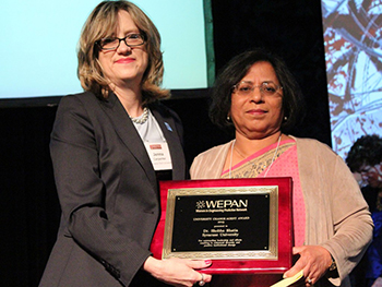 Shobha Bhatia, right, accepts the assdf Award from Jenna Carpenter, dean of the School of Engineering at Campbell University and president of WEPAN.