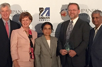 iSchool Professor Bruce Kingma, second from right, accepts the award on behalf of the University.