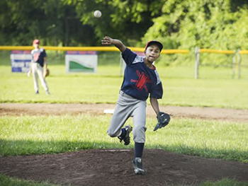 •Jondale Dávila, 12, is a star pitcher for Syracuse Parks and Recreation's District 8 Little League Baseball. (Photo by Marilu Lopez Fretts)