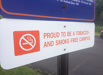 Signs have been posted around campus indicating the University's new status.