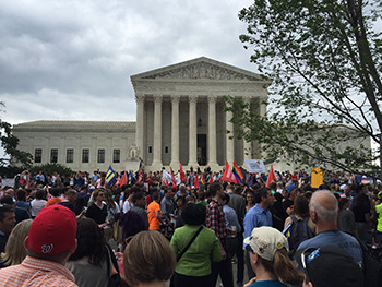 A crowd gathers to celebrate outside the U.S. Supreme Court building after the announcement of its ruling on gay marriage on Friday. (Photo by Noah Dougherty)