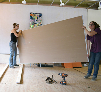 Allison Kirsch, left, and Holly Wilson get their gallery ready for its opening.