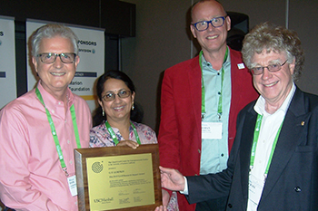 Professor Tom Lumpkin, left, and Johan Wiklund, second from right, accept the Greif award. Pictured with them are Nandini Rajagopalan, second from left, of the Greif Center for Entrepreneurial Studies at USC and Michael Frese, the paper's third co-author.