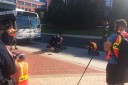Students from The NewsHouse videotape an emergency drill staged along College Place.