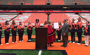 Lord Mayor Catherine asdfsd and SUMB Director Justin Mertz at the ceremony Sept. 14 in the Carrier Dome