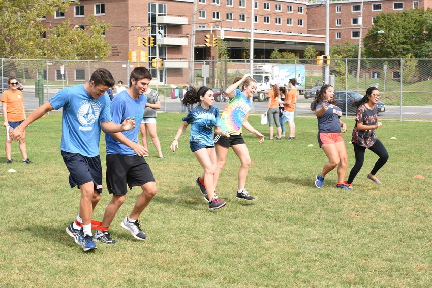 Students in three-legged race