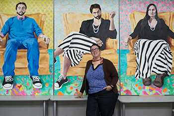 "Artist Julie Pratt in front of her triptych ""Perception"" (Photo by Amrita Stuezle)"