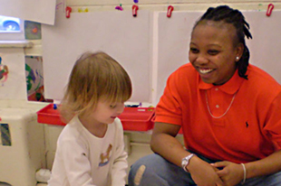 Teacher and toddler in Falk graduate program