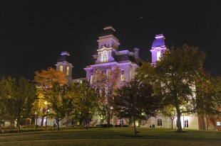 "The Hall of Languages is lit up in purple in a previous year to ""Shine the Light on Domestic Violence."""