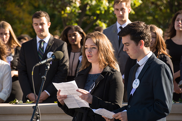 2014-15 Lockerbie Scholars Megan Noble and Will Beech honor the Lockerbie victims of the Pan Am 103 bombing during the 2014 Rose-Laying Ceremony at the Wall of Remembrance.