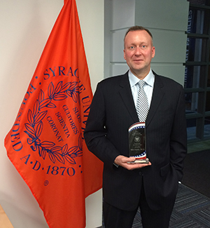 J. Michael Haynie with his award for 2015 Onondaga County Veteran of the Year (Photo by Wayne Westervelt)