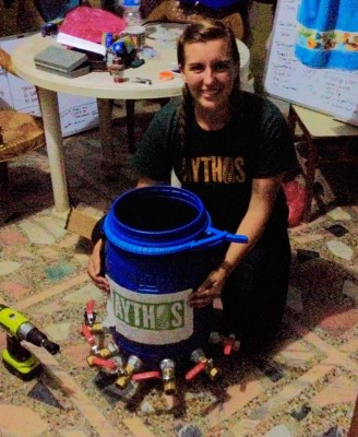 Rachel Penner displays a water distribution tank that allowed the biosand-filtered water to be distributed to different housing clusters in a Nepalese village. Penner designed the tank to ensure the structural integrity of the main, 2,000-liter storage tank.