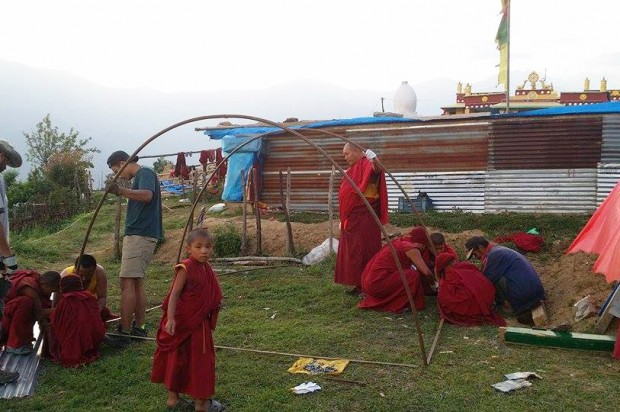 Volunteers help construct shelters at a Buddhist nunnery in Helambu. Aythos and ROKPA International teamed up to deliver eight shelters that will allow the nuns to continue their studies until the nunnery is rebuilt.