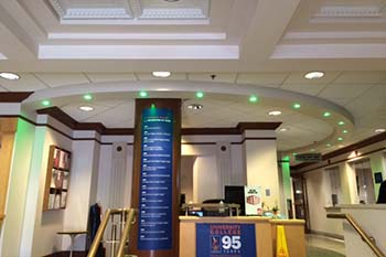 "University College lights its lobby in green to support the ""Greenlight a Vet"" campaign."