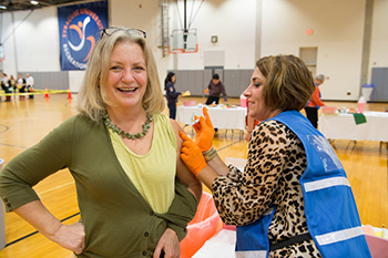 A staff member gets vaccinated at one of last year's flu shot clinics.