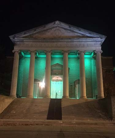 "Hendricks Chapel is lit up in green as part of the ""Greenlight a Vet campaign."