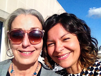 Tere Paniagua '82, left, with Margaret Salazar-Porzio, curator in the National Museum of American History