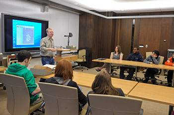 Associate Professor of History Christopher Kyle teaches a class in the Lemke Room in the Special Collections Research Center.
