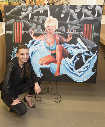 "McKinney with her painting ""Title IX."""