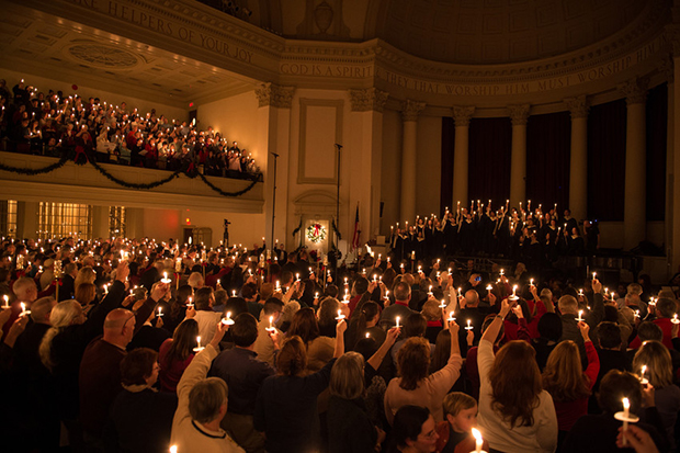 "Concertgoers hold candles while they sing ""Silent Night"" at the end of last year's ""Holidays at Hendricks"" concert."