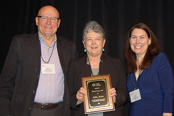 Kathy Hinchman, center, receives the adfasdf award. With her are David Reinking of Clemson University and Jill Castek, asdfasdf.