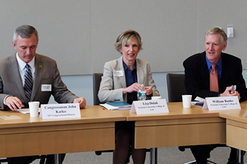 Lisa Dolak, center, chairs the intellectual roundtable, which included Congressman John Katko, left, and the College of Law's interim dean, William Banks, right.