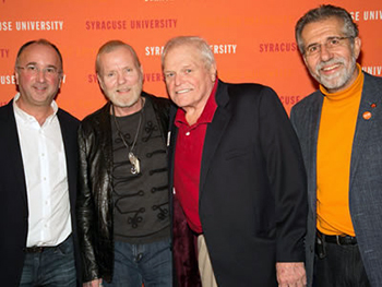 David Rezak (far right) with artist manager Michael Lehman (far left), musician Gregg Allman, and actor Brian Dennehy at a Syracuse alumni event. (Photo by Eric Weiss)