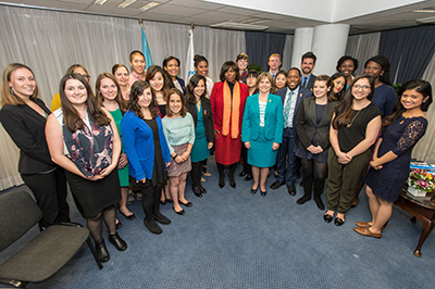 "Professor Catherine Bertini (right of center, in teal) and Ertharin Cousin (center, orange scarf), director of the UN World Food Programme, with members of Bertini's ""Food Security and Policy"" class in Rome."