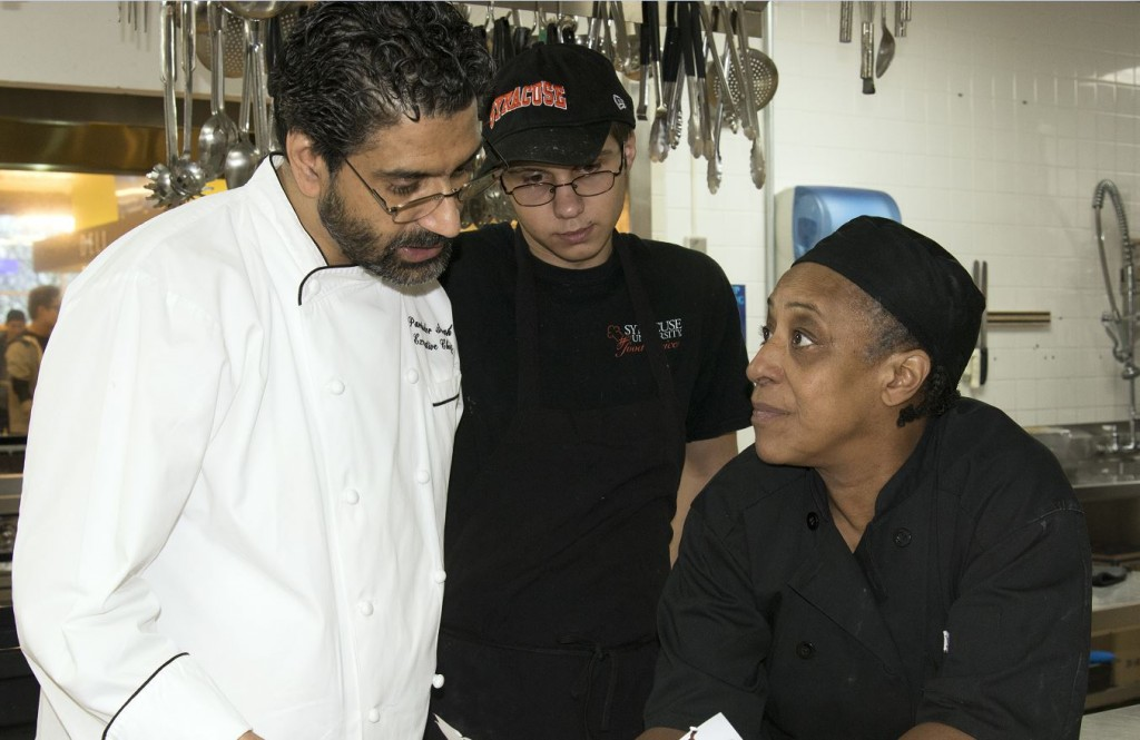 Executive Chef Parvinder Singh with temporary employee Tyler McJilton and Joyce Burwell, First Cook