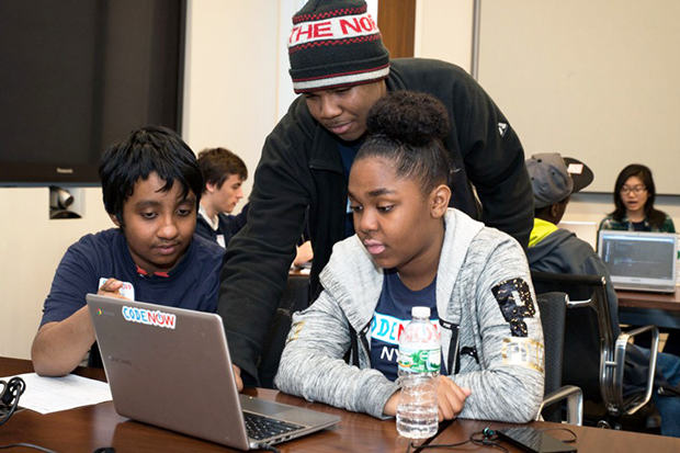 Marcus Robinson works with students as part of the CodeNow program to assist youngsters in learning computer coding. (Courtesy of CodeNow)
