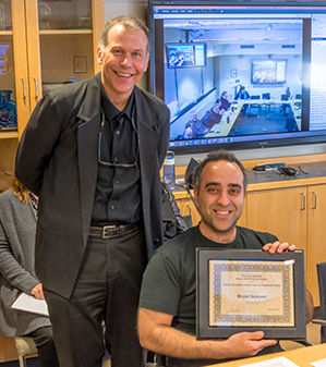 Interim Dean Jeffrey Stanton, left, presents the Robert Benjamin Junior Faculty Research Award to Assistant Professor Bryan Semaan.