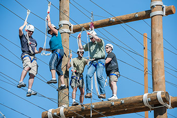 The ITS Information Security Team works its way through the outdoor Challenge Course.