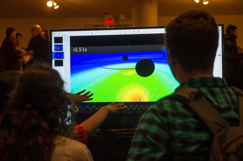 Students looking at computer image