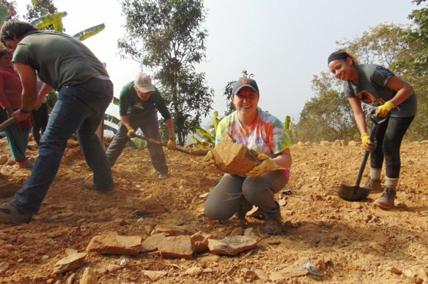 Team members help to clear land in a village in Nepal. From left are Robert McMillian; Collin Bartholomew, a SUNY ESF 2013 alumnus; Samantha Mozden '18; and Vivian Gomez '15. Photo by Katherine Bartholomew '11.