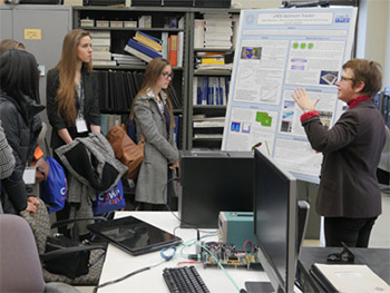 Marina Artuso, right, a world-renowned particle physicist at Syracuse, discusses her research with CUWiP participants.